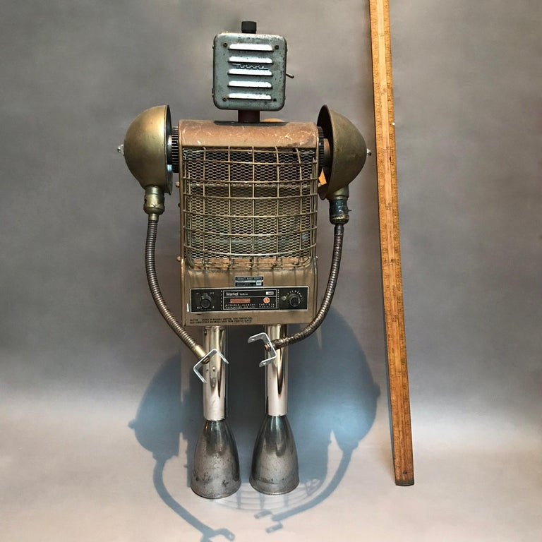 Custom robot sculpture named Markel by Bennett Robot Works, Brooklyn, NY  Bennett Robot Works, robot sculptures created by Gordon Bennett, are composed of found objects used in their unaltered entirety. They are inspired by Norman Bel Geddes and