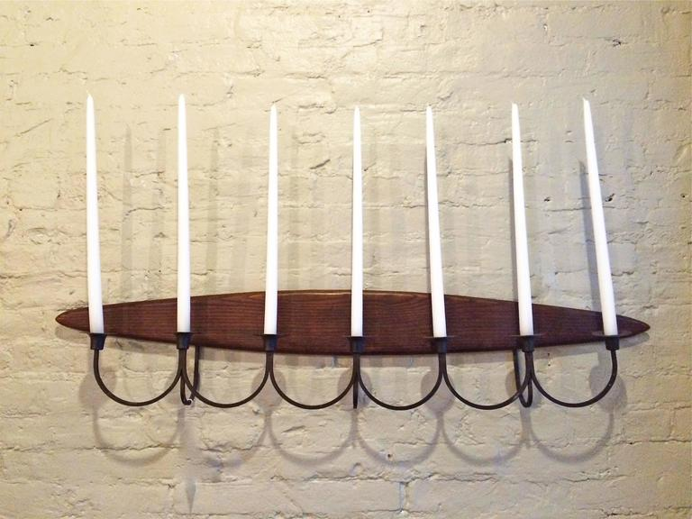Mid-Century Modern, wall mount, candelabra or candle sconce by Raymor with elliptical shape walnut back and wrought iron candle holders.