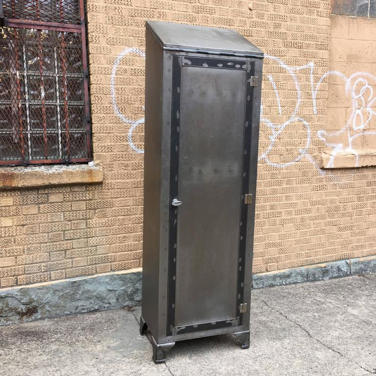 Tall, Industrial, brushed steel, hospital locker by Thorner Manufacturing Co, NYC. Spacious interior includes rods for hanging clothes and a mirror on the door.