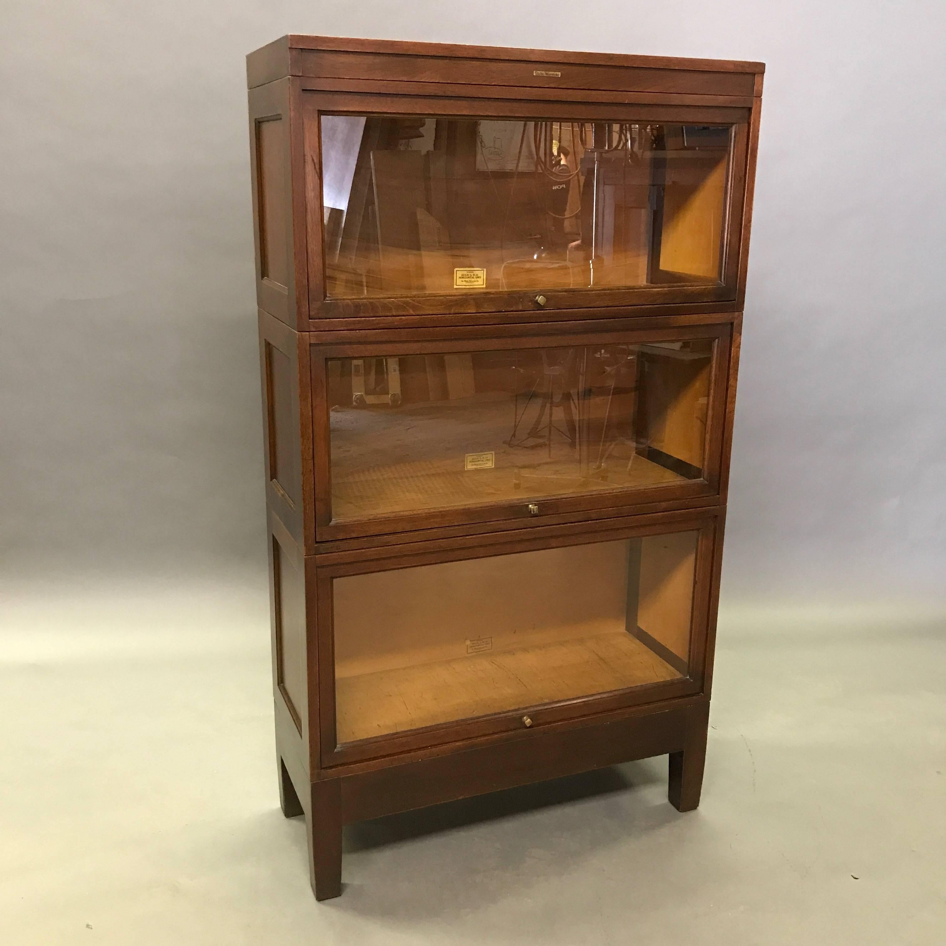 placed tall lacquer nronze handle white metal brown bookcase using vintage with antique glossy sliding bookcsae bookshef glass bookcases designs wood furniture wooden ceramic teak dark tiled narrow doors door on floor