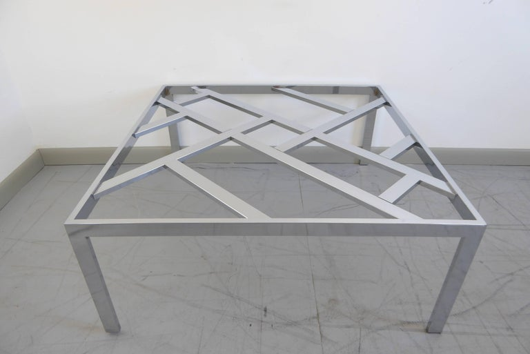 Chrome and glass cocktail table by Milo Baughman for DIA, 1970s. Gleaming chrome and stunning design.