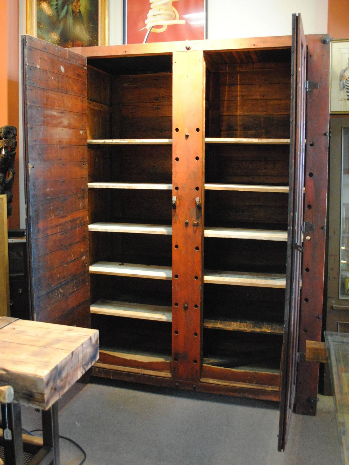 Large rustic wood storage cabinet at stdibs
