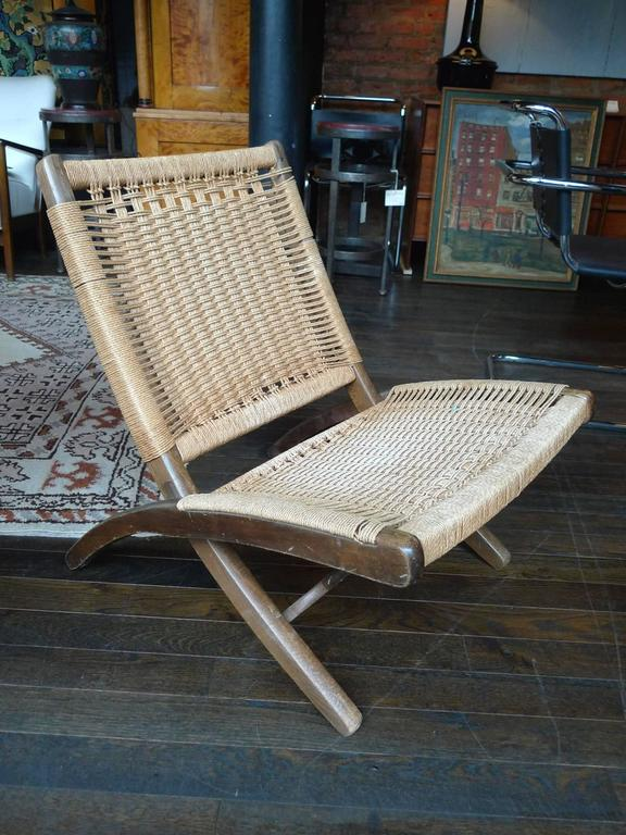 This Mid Century Modern Folding Chair Is In The Style Of Hans Wegner. Its