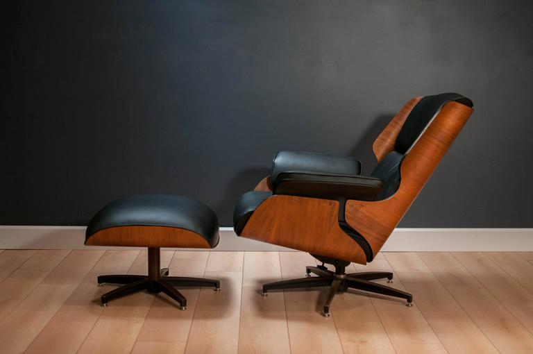 Mid-Century Modern drexel declaration lounge chair and ottoman designed by Kipp Stewart & Stewart McDougall. This piece features a stunning bent plywood frame with walnut finish. Comfortable black leather cushions are perfect for lounging.