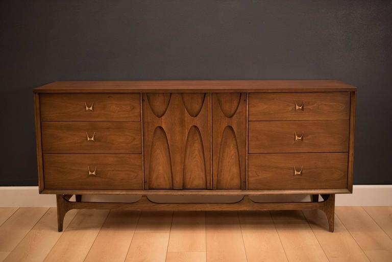 Mid-Century Brasilia triple dresser manufactured by Broyhill Premiere, circa 1960s. This piece highlights Oscar Niemeyer's iconic signature sculpted arches of Brazil. Includes plenty of storage space with nine drawers.
