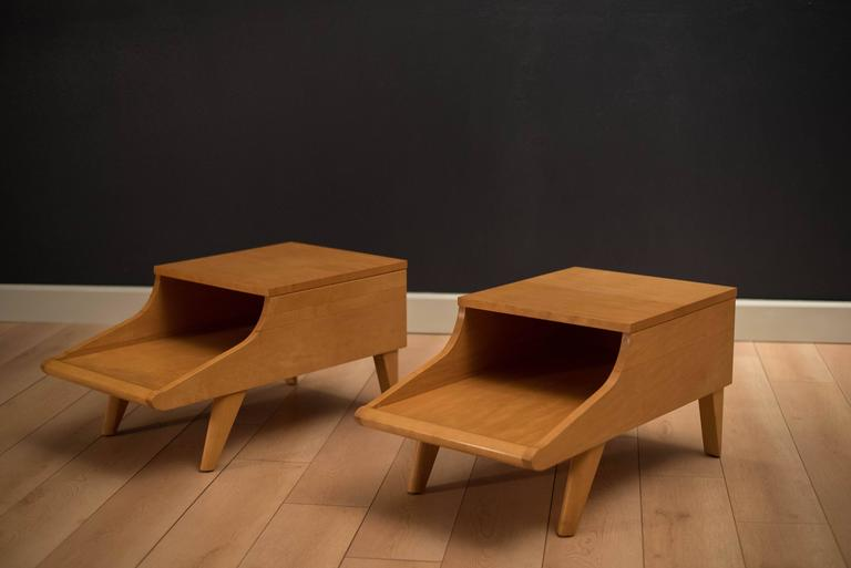 Mid-Century side tables designed by John Keal for Brown Saltman. This two-tier table set features unique splayed legs and is made of solid maple in the original blonde finish. Price is for the pair.