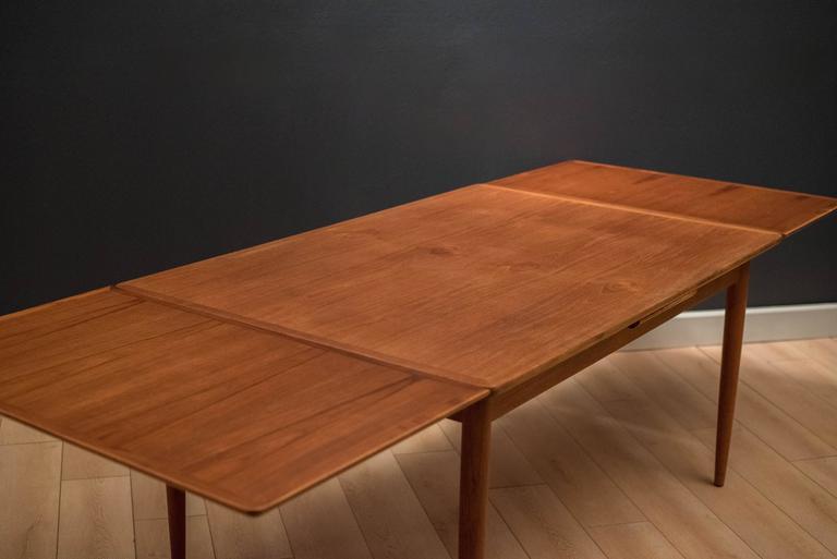 Scandinavian Modern Danish Teak Draw Leaf Dining Table For