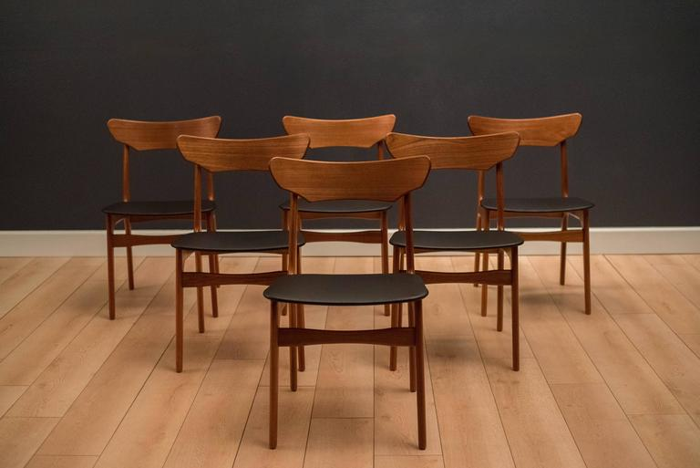 Mid-Century set of six dining chairs by Schionning & Elgaard in teak. This set has new upholstered seats in black vinyl.