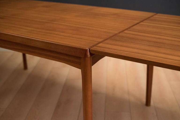 Scandinavian Modern Danish Teak Dining Table by Henning Kjaernulf For Sale