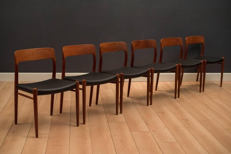 Mid century Niels Moller dining chairs in teak, circa 1960s. This set includes six model no. 75 chairs. Seats have been professionally reupholstered in black leatherette.