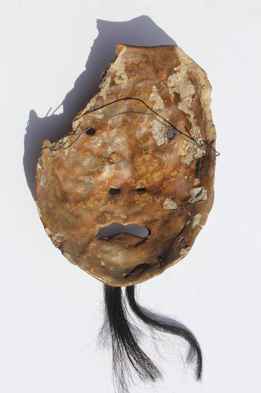 Asian mask fragment. Circa 1900.