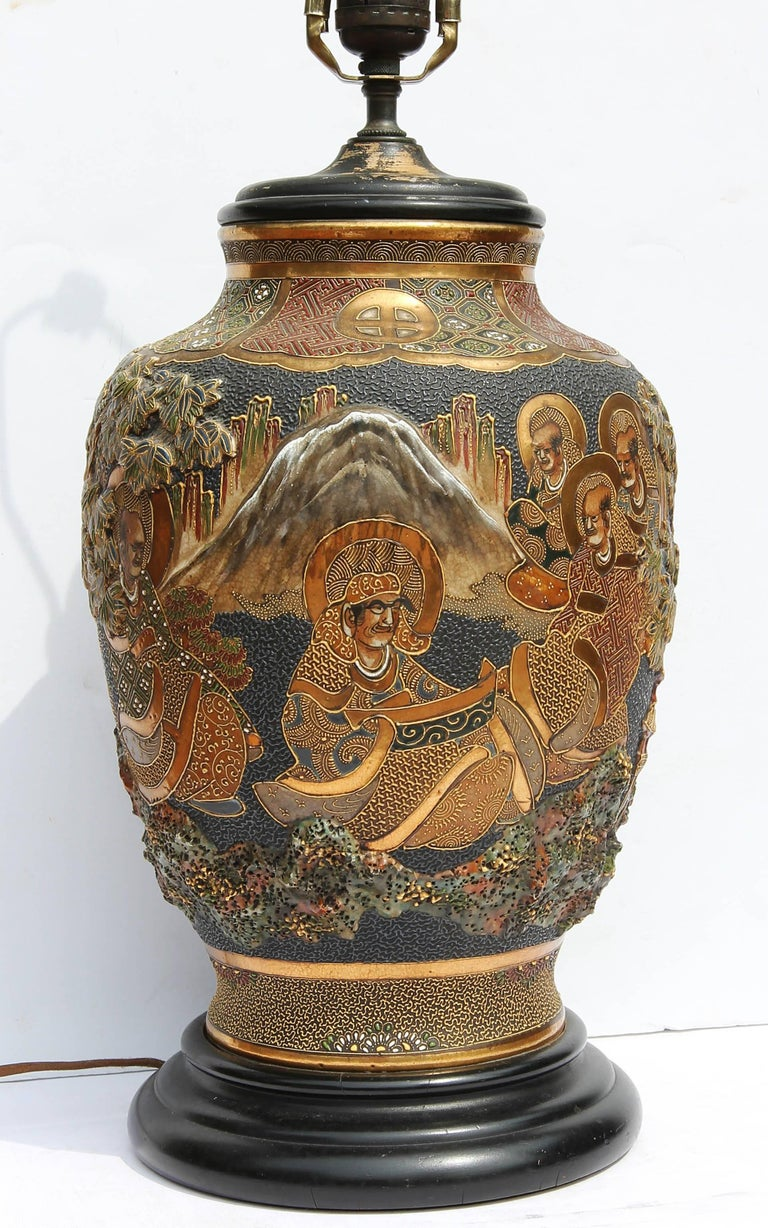 Antique Japanese Satsuma lamp. Gilt and glazed decoration, showing scholars in a landscape. Exceptional quality and depth. Circa 1920.