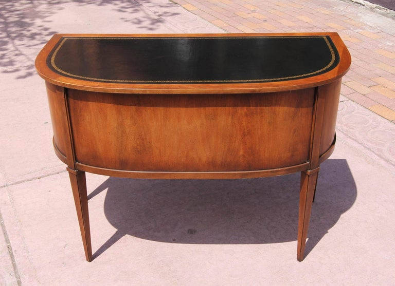 Vintage neoclassical desk with tooled leather top. Made by Sligh-Lowry. Pecan wood, circa 1960s.