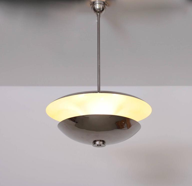 Rare 1930s nickel pendant lamp in excellent condition and newly wired. 3x E27 To be on the safe side, the lamp should be checked locally by a specialist concerning local requirements.  *This piece is curated for you by Original in Berlin*