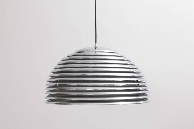Rare large version of the Kazuo Motozawa Saturno pendant light by Staff in chrome. The inside lacquer is peeling off. That does not affect the beautiful light. Fully original. 4x E27/Model A. To be on the safe side, the lamp should be checked