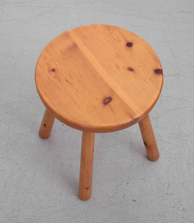 Beautiful strong solid pine Perriand stool in very good condition and a strong pine color!