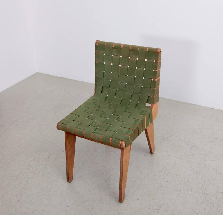 Hand built chair with green army surplus strapping and pitch pine frame, 1949. Klaus Grabe was a German designer and architect who emigrated to the United States with fellow Bauhaus members in 1933. Influenced by Breuer's works in plywood, Grabbe's