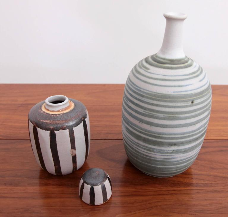Mint set of of two ceramic vases by Ahsltrom. Very nice glaziers. The size is the bigger green striped one.