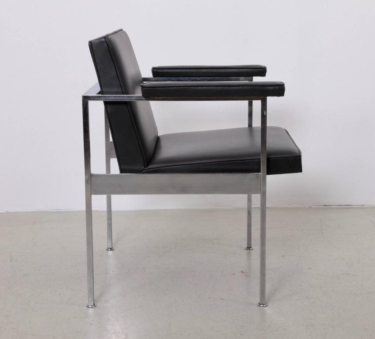 Set of four armchairs by George Nelson for Herman Miller in black aniline leather. Original Herman Miller circle tag present to underside as shown.