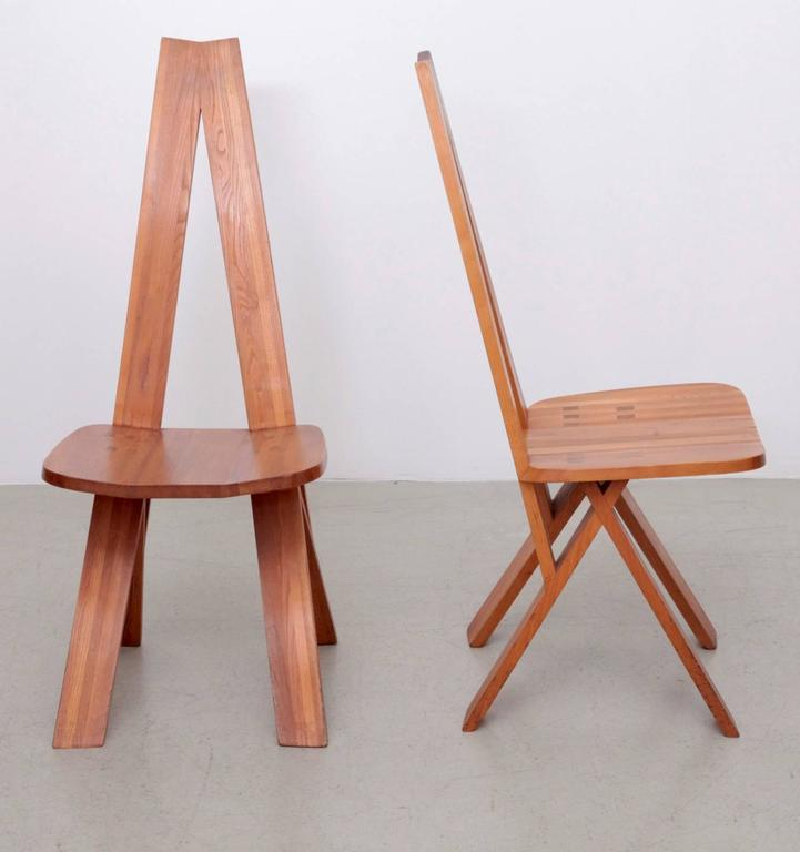 Pair of solid elmwood S45 chairs by Pierre Chapo, produced in the 1970s. The chairs show light marks of age but they are very strong and ready to use. In total four pieces are available.