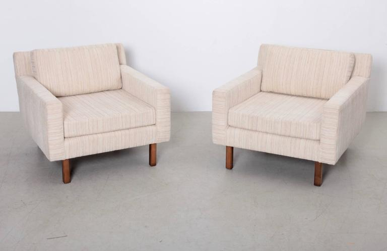 Pair of Milo Baughman lounge chairs in a cream fabric and solid wood feet. Good vintage condition.