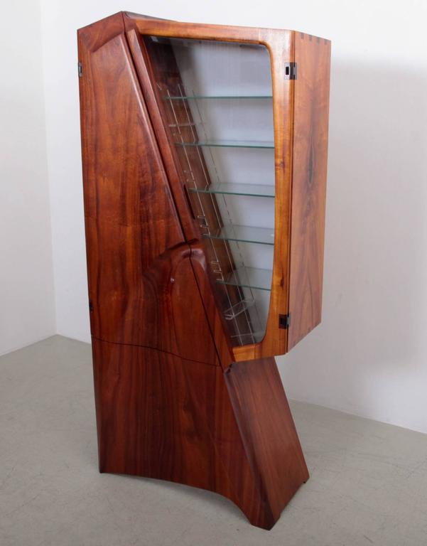 Absolute high end studio wall cabinet by Charles B. Cobb. Made in American walnut. Inside has drawers. The glass side has a light behind the perspex. All hinges are made in wood. A fantastic piece of American studio craft.