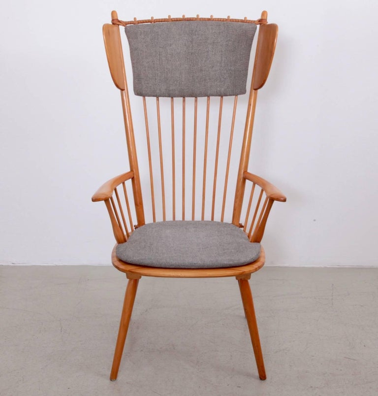 Rare high wingback edition of the architectural Arts & Crafts chair by Albert Haberer for Hermann Fleiner, Stuttgart, circa 1949. The flexible backrest is made of thin spindles, held together with a leather connection. The leather is a beautiful