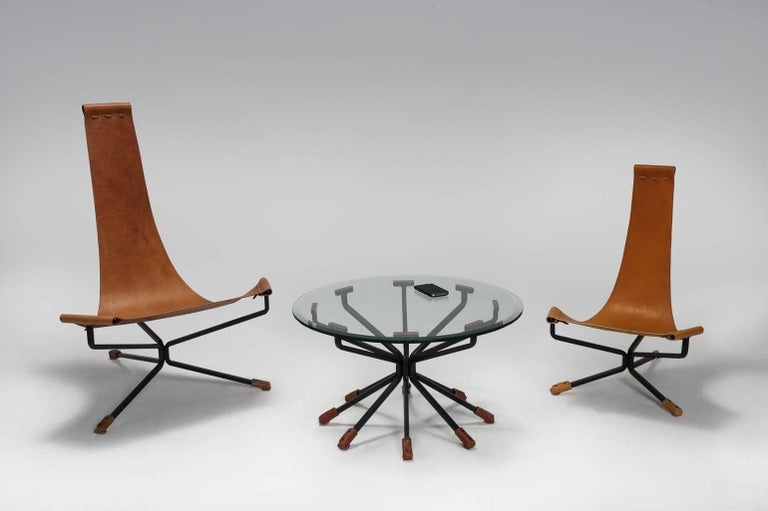 Mid-Century Modern Coffee Table with Glass Top, Steel Legs and 12 Leather Trim Legs by Dan Wenger For Sale