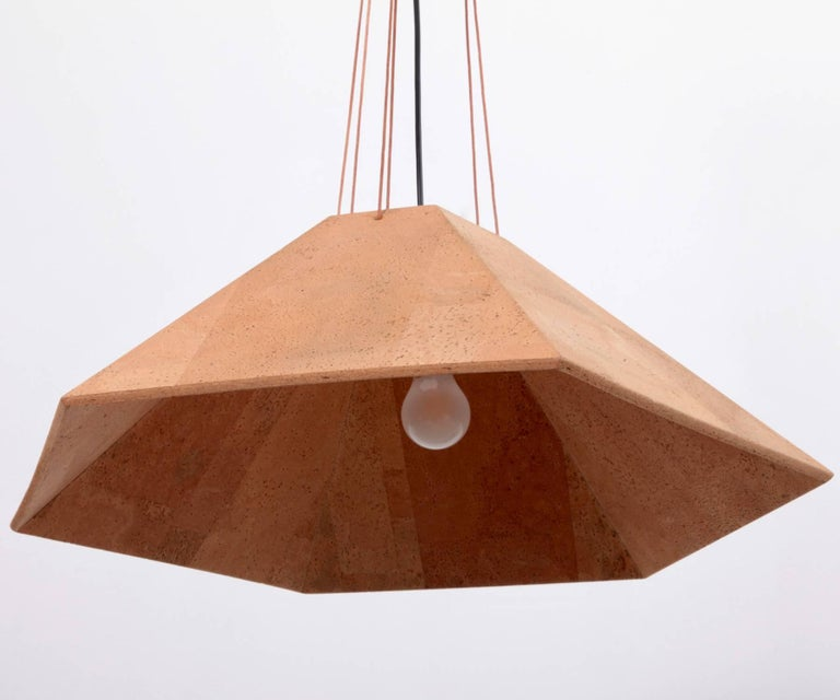 Excellent cork pendant lamp with leather strings in excellent condition by Wilhelm Zannoth for Ingo Maurer. Signed! One x E27 / model A bulb.
