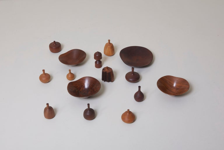 This collection of eleven vases and four bowls were handmade by Rude Osolnik, the midcentury master of woodturning. Osolnik's work is held in many important collections, and a piece of his was even presented to the Queen of England by the United