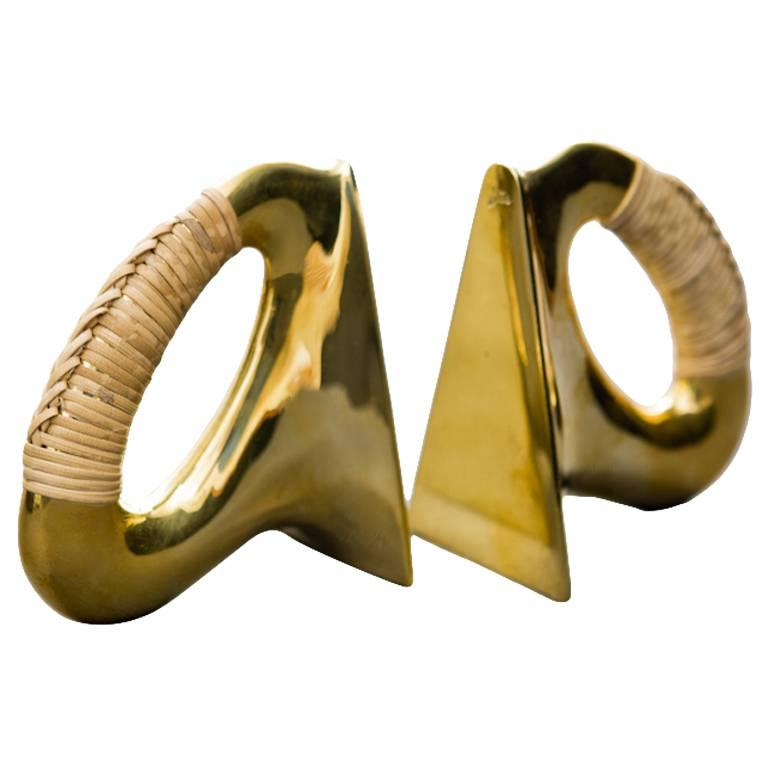 Pair of Carl Auböck Bookends in Polished Brass and Coiled with Cane