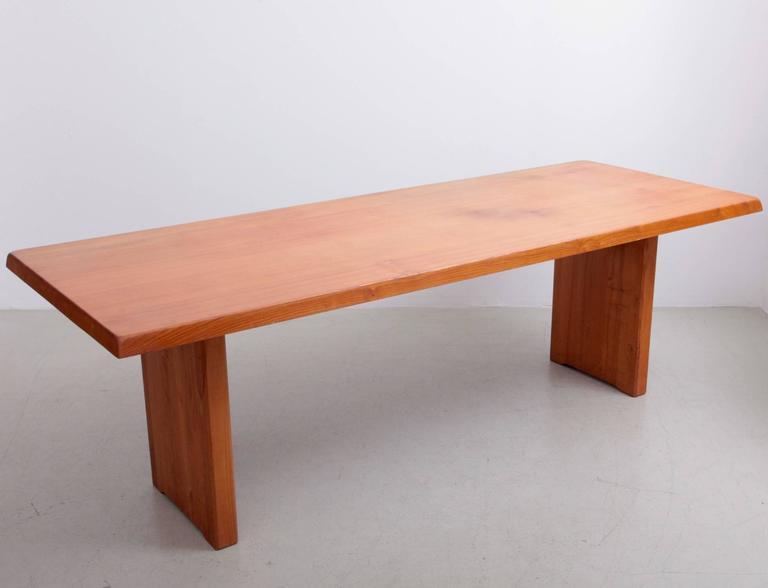 This is a rare larger version of a Classic Pierre Chapo dining table design. Made in solid elm and Charlotte Perriand like wooden connections. A French Classic high quality table in excellent condition.