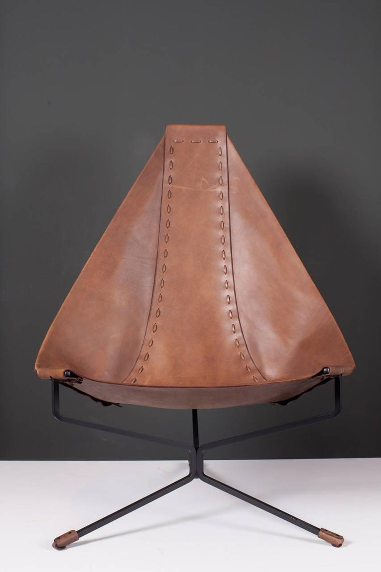 Lounge chair made of Latigo leather on a black steel base. The lotus chair was designed in 1969 while Daniel was living in Topanga Canyon, California. In 1970, he moved his design activities to Soquel, California, where he built a workshop in an old