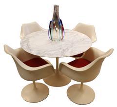 Saarinen for Knoll Marble Tulip Dining Table and Four Saarinen Armchairs