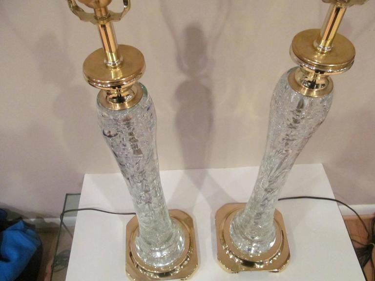 Amazing pair of rock crystal table lamps. Each has one very large stand alone piece. Rare and beautiful sculptural table lamps rewired and ready for use.