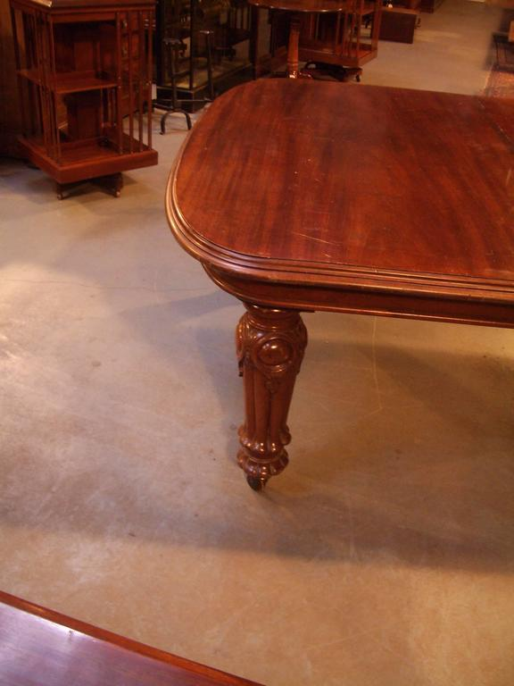 A superb Victorian extending dining table in mahogany with five leaves, it has five legs which makes for a very sturdy table with no sag in the middle when fully extended, it can be used with any combination of leaves, it is a wind out table. It