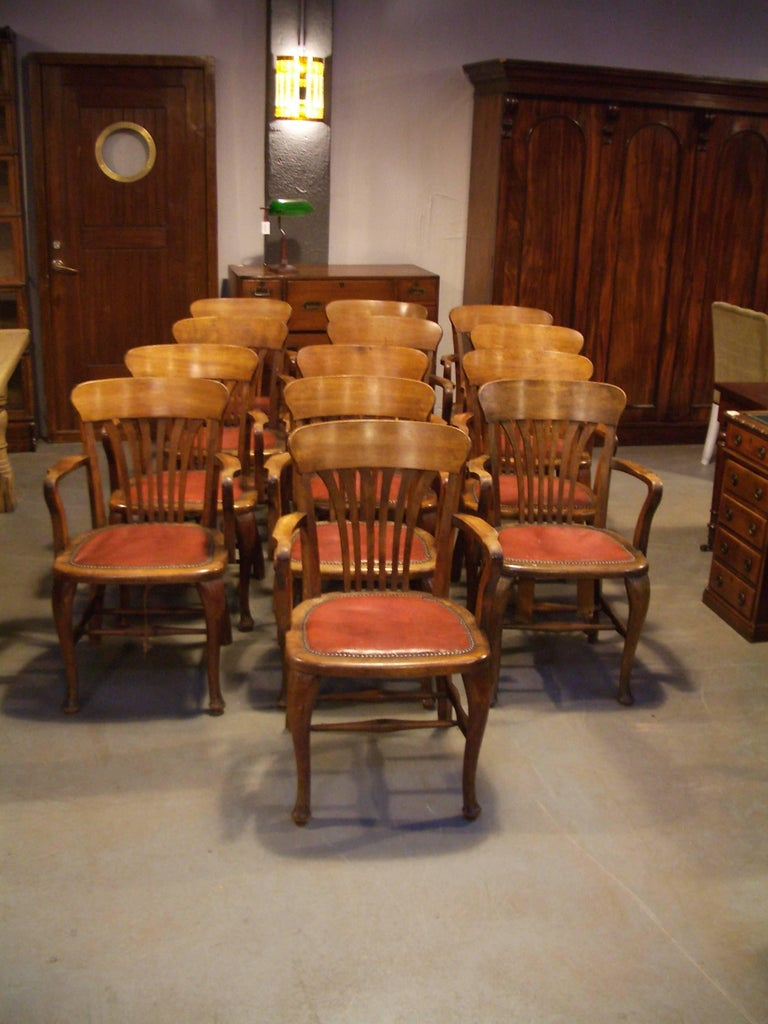 Unique set of 13 mahogany office chairs, good to use for a meeting table or as dining chairs.