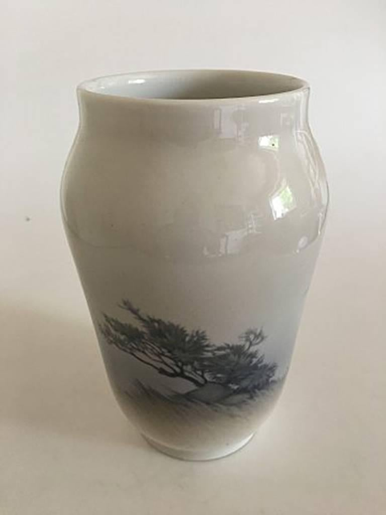 Royal Copenhagen vase #2253/1217 with landscape motif with two white ducks. Measure: 25 cm H (9 27/32 in). 1st Quality. In perfect condition.