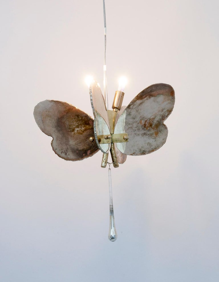 Suspended light, ethereal, graceful, elegant, Delicate. I can imagine this butterfly hanging near a window, an armchair, a passage, the children's room, in the makeup room of a lady, in the Great Hall of a charming hotel, in the bedroom, above the