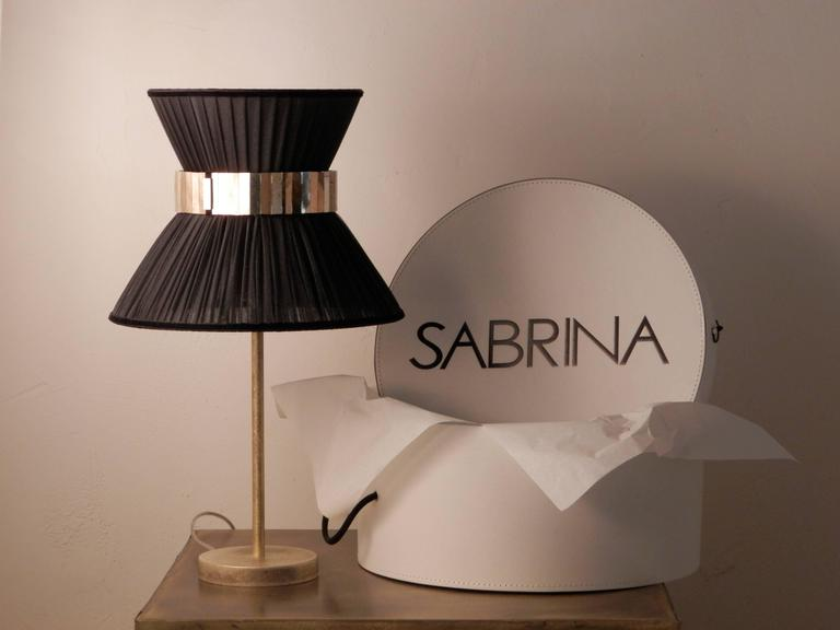 This light object  is a contemporary piece, entirely made in Tuscany and produced 100% by hand in Sabrina Landini 's atelier.  The Tiffany lamp is Sabrina's first creation and is inspired by Audrey Hepburn's timeless charm. Attractive,