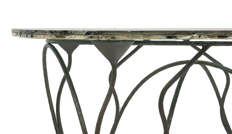 Flower dining or console table, It is a single table of its kind, which is made on custom both in hand-forged iron and in bronze, as a true sculpture. It is a combination of an art Nouveau base and a glass surface of contemporary art. The metal