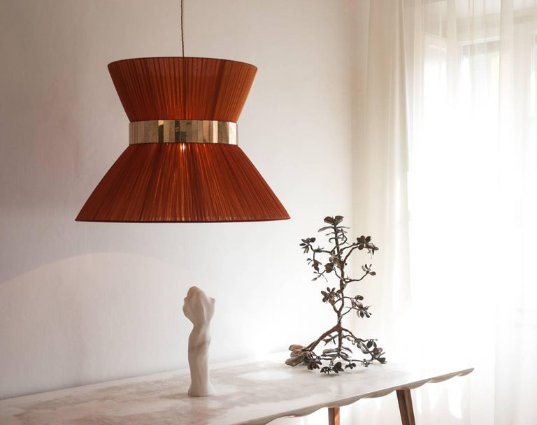 This hanging lamp is a contemporary piece, entirely made in Tuscany and manufactured in an artisanal way.  The lampshade is made of soft pleated bright silk organdy, available in 12 colors. This lampshade has also a central ring made of glass
