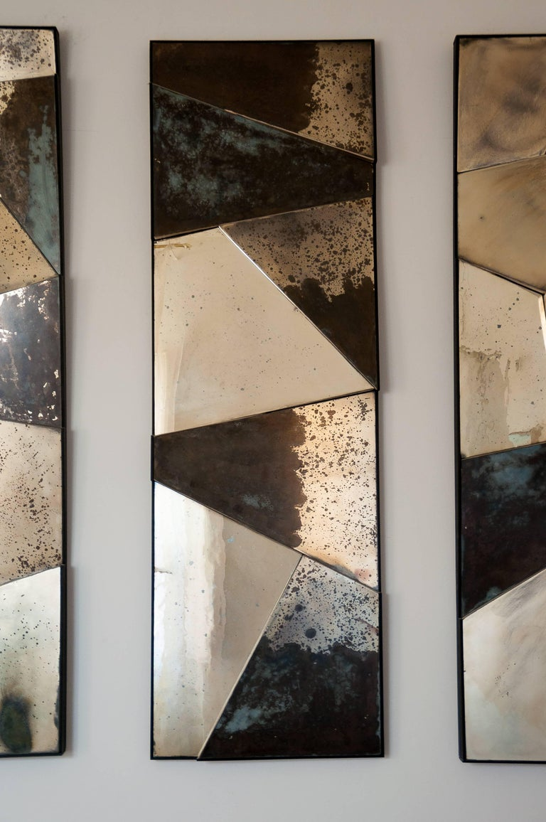 Three-dimensional sculpture mirrors in contemporary silver glass. The pieces radiate reflections and interact with the surrounding environment with elegance and character.  Each of the three pieces measures H. 160xw50xd10cm, it is recommended to