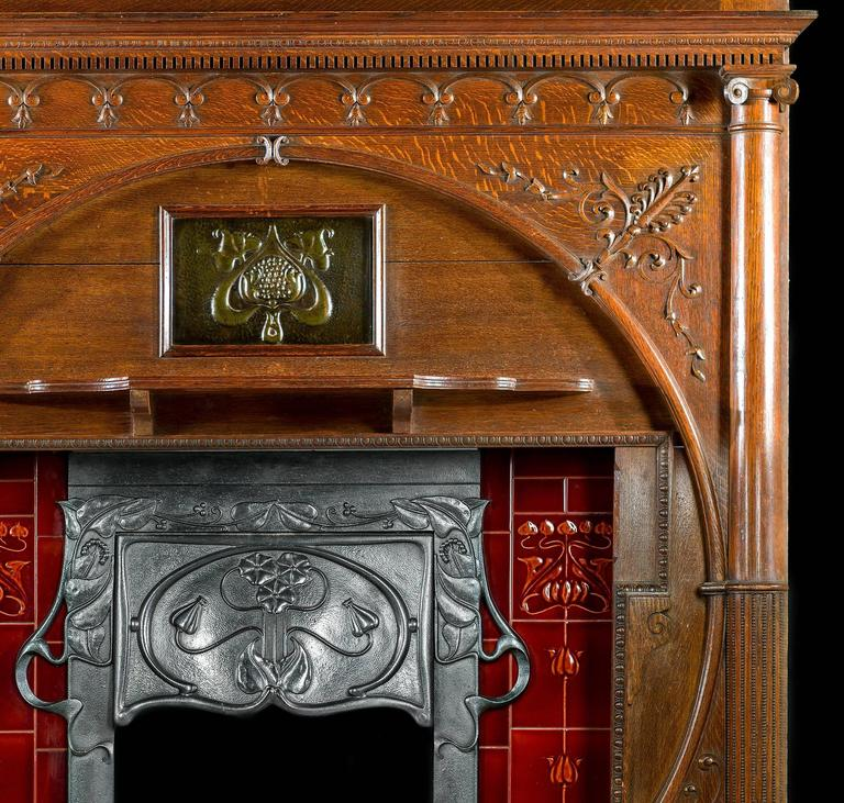 carved oak art nouveau antique fireplace mantel and integral cast iron insert 3 - Antique Fireplace Mantels