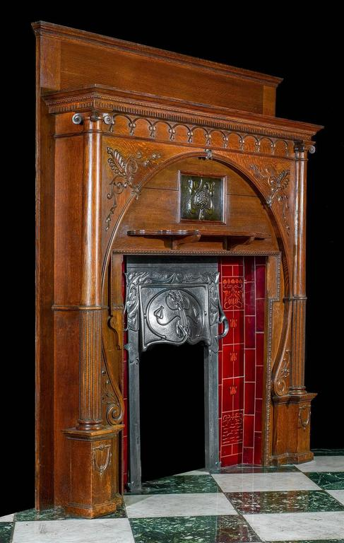carved oak art nouveau antique fireplace mantel and integral cast iron insert 2 - Antique Fireplace Mantels