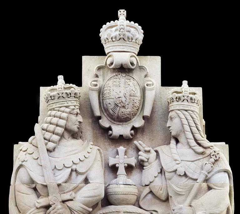 A massive carved Portland stone tableau of the reigning monarchs, William & Mary (1689-1702), granting The Bank of England Charter in 1694. Sculptor Esmond Burton (1885-1964).  Part of a collection of approximately 45 statues and carvings