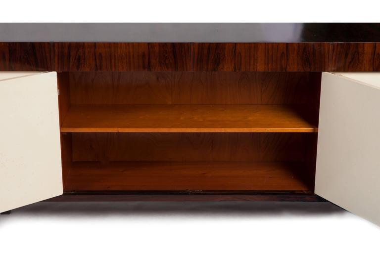 This monumental 13-foot Brazilian modern rosewood (Jacaranda) cabinet-buffet was a privately commissioned piece designed by Joaquim Tenreiro.