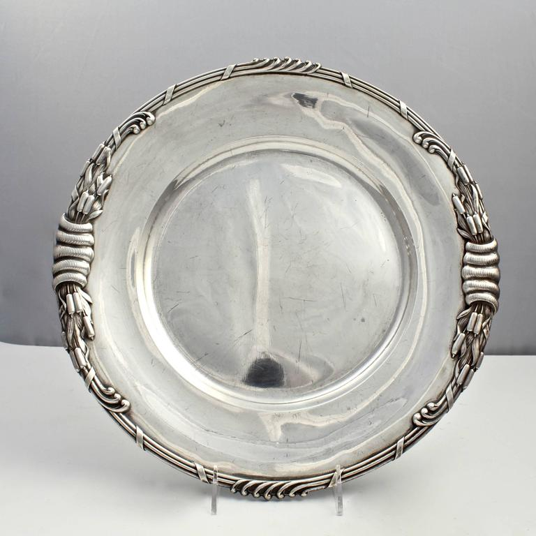 An incredibly heavy pair of period Art Nouveau Dutch sterling silver round serving trays from a large service by Ph. Saakes of the Hague. 