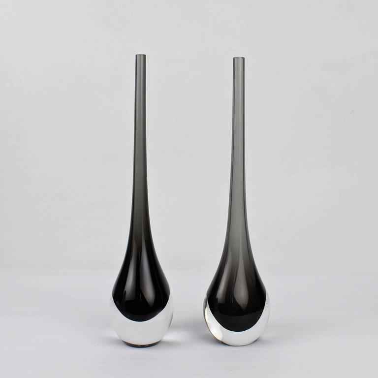A fine associated pair of Cenedese Sommerso glass bud vases.  Grey and clear glass.  Height: circa 12 in.  Items purchased from David Sterner Antiques must delight you. Purchases may be returned for any reason for a period of 7 days.