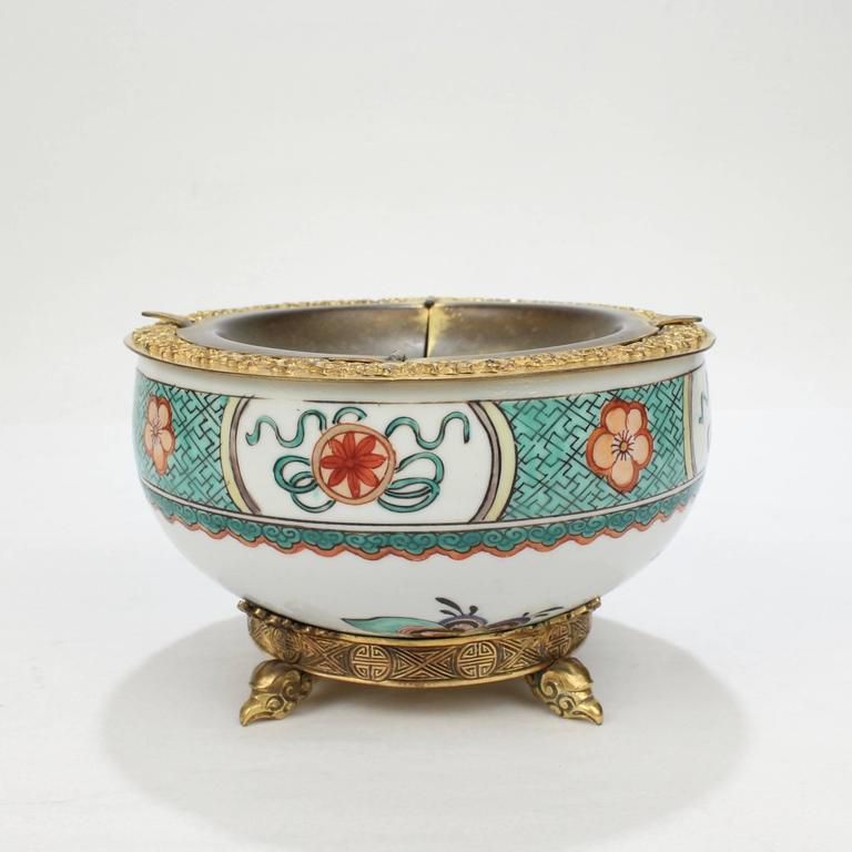 A superb, signed E F Caldwell bronze-mounted inkwell.   A decadent piece from America's Gilded Age.  Constructed of an antique famille verte Chinese porcelain bowl and Chinese style bronze mounts.   Insert is marked for E F